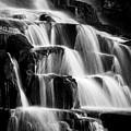Dark Waterfall In Monochrome  by Rikk Flohr