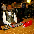 Dealer In Las Vegas Casino by John Malone