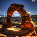 Delicate Arch Framing La Sal Mountains by Roger Passman