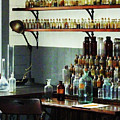 Desk With Bottles Of Chemicals by Susan Savad