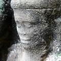Detail Of Stone Carving Near Angkor Wat, Cambodia by John Cumbow
