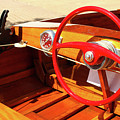 Detail Of Wood Speed Boat With Bright Red Steering Wheel  by Susan Vineyard