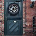 Door And Wheel by Douglas Barnett