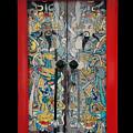 Door Gods With Red Door Frame by Ty Lee
