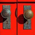 Doorknobs On Red Door by Garry Gay