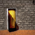 Doorway To A Yellow Curtain by Wayne King
