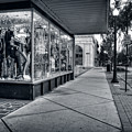Downtown Sidewalk In Black And White by Greg Mimbs