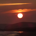 Crimson Ocean Sunset by Andrea Freeman
