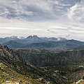 Dramatic Panoramic View Of Snow Capped Mountains Of Northern Cor by Jon Ingall