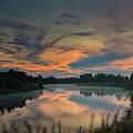 Dramatic Sunset Over The Misty River by Jukka Heinovirta