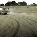 Drifting Tracks Japanese Car Drifting Round A Corner With Tyres Smoking by Andy Smy