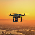 Drone Flying On Sunset by Ron Ardity