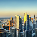 Dubai Towers At Sunset. by Dmitrii Telegin