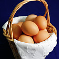 Eggs In A Wicker Basket. by Gaspar Avila