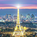 Eiffel Tower And City Of Paris From The Top At Dusk, France by Matteo Colombo