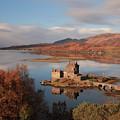 Eilean Donan Castle In Autumn - Long Exposure by Maria Gaellman