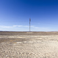 Electricity Pylon In Desert by Gal Eitan