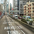 Elevated Road In The Very Crowded Causweay Bay District In Hong  by Didier Marti