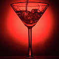 Empty Cocktail Glass On Red Background by Oleg Yermolov