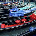 Empty Gondolas Floating On Narrow Canal by Sami Sarkis