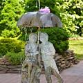 Enjoying Rain Showers by Sonali Gangane