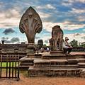 Entrance To Angkor Wat  by Chuck Kuhn