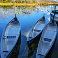 Evening Canoes At The Dock by Debra and Dave Vanderlaan