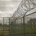Exercise Yard Through Window In Prison by Karen Foley