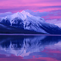 Extreme Sunset On Lake Mcdonald by Larry Kjorvestad
