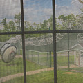 Prison Yard With Razor Wire, Guard House And Satellite Dish by Karen Foley