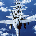 Fa-18c Hornet Aircraft Fly In Formation by Stocktrek Images
