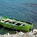 Faded Green Yellow Motor Power Boat Parked At Satpara Lake Pakistan by Imran Ahmed
