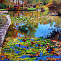 Fall Leaves On Lily Pond by John Lautermilch