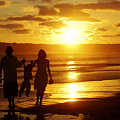 Family Walk On Beach by Jill Reger