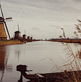 Famous Windmills At Kinderdijk, Netherlands by Alexandre Rotenberg