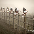 Farm With Fence And American Flags by Jim Corwin