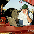 Farmer With Laptop And Cell Phone by Inga Spence