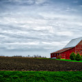 Farming Red Barn On A Quite Spring Day by Thomas Woolworth