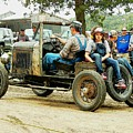 Father And Daughter In The Tractor Parade by Curtis Tilleraas