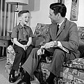 Father And Son Talking And Smiling by H. Armstrong Roberts/ClassicStock