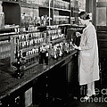 Female Scientist Conducting Experiment by Wellcome Images