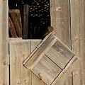 Fence Posts In Barn by Carl Miller
