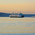 Ferries At Sunset by Karen Ulvestad