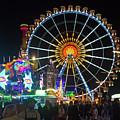 Ferris Wheel At Night by Bernard Barcos