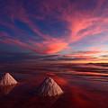 Fiery Clouds Over The Salar De Uyuni by James Brunker
