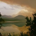 Fire Over St Mary Lake by Tracey Vivar