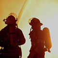 Firefighters In Silhouette by Jack Dagley