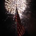 Fireworks Behind American Flag by Alan Look