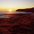 First Light On Red Sandstone Beach by Chris Bordeleau