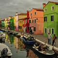 Fisherman At Work In Colorful Burano by Tim Kathka
